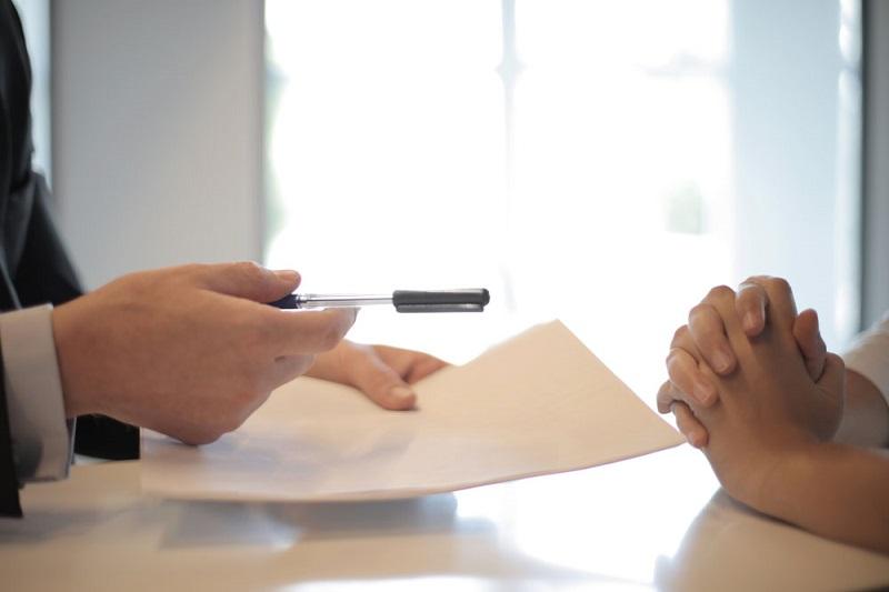 Man handing over contract